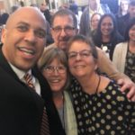 Nancy appears in a selfie with Senator Cory Booker