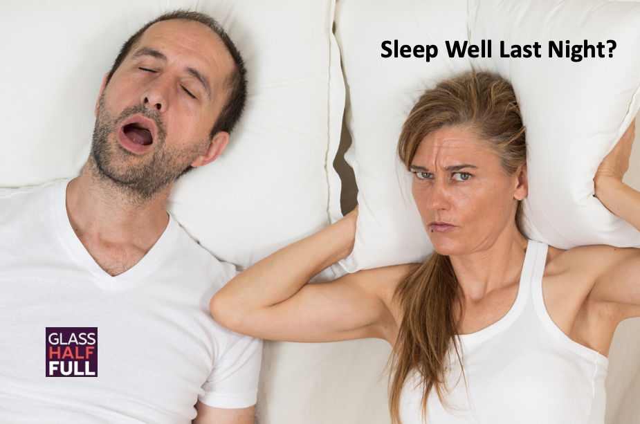 Man snoring in bed, woman awake